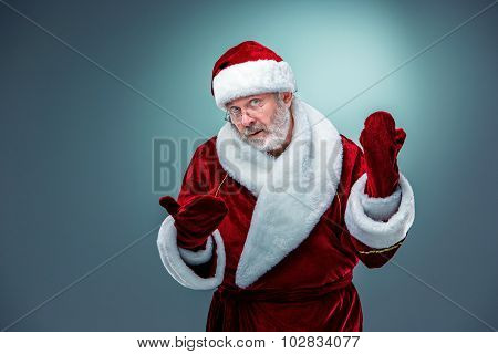 Santa Claus, presenting something.