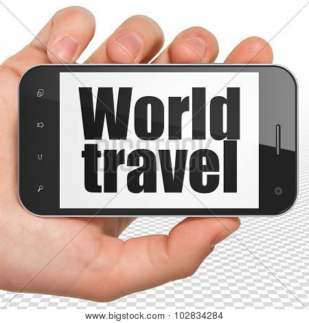 Tourism concept: Hand Holding Smartphone with World Travel on display