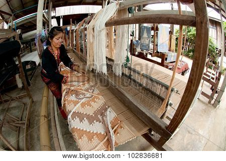 Lua Hill Tribe Minority Is Weaving With Loom In Thailand.