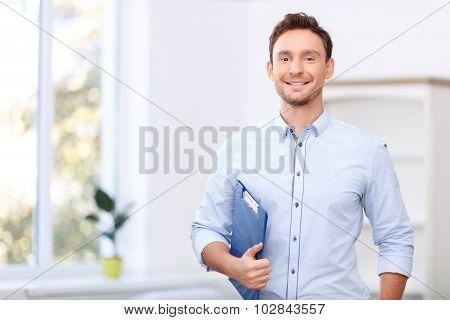 Nice realtor holding folder