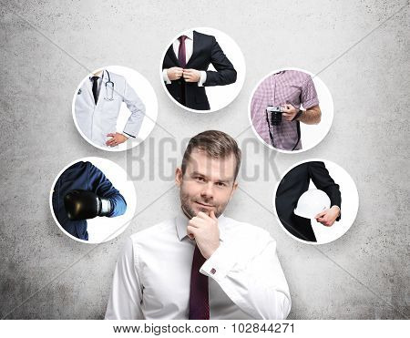 A Handsome Person In A Formal Shirt Is Thinking About Different Professions. Concrete Background.