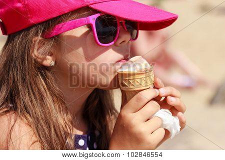 Little Girl Kid Eating Ice Cream On Beach. Summer.