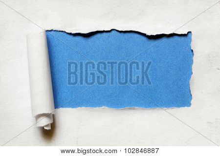 Torn paper over a blank blue background for message