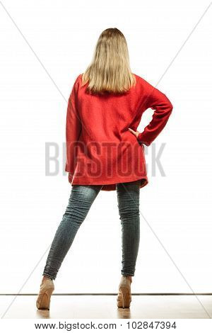 Fashion Woman In Vivid Color Red Coat Rear View