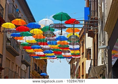 Street installation of colorful umbrellas.