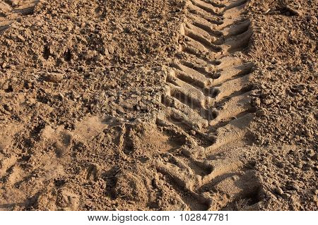 Tractor wheelmark on agricultural soil