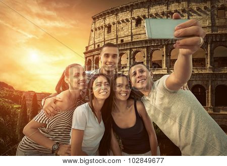 Self of Group friends on the one of the most popular travel place in world - Roman Coliseum.
