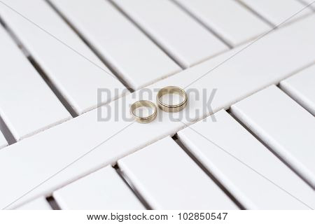 Gold Wedding Rings Lie On A White Background