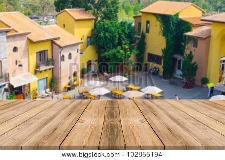 Wooden Board Empty Table blur beautiful resort - can be used for display or montage your products.