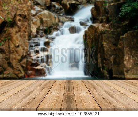 Wooden Board Empty Table blur waterfall in forest - can be used for display or montage your products
