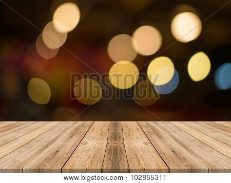 Wooden Board Empty Table Blurred bokeh light - can be used for display or montage your products.