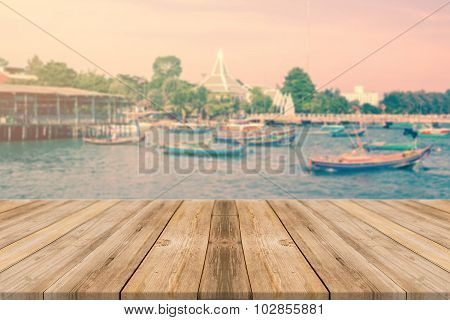 Wooden Board Empty Table blur boat in port - can be used for display or montage your products.