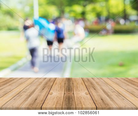 Wooden Board Table blurred people activities in park - used for display or montage your products.