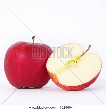 One And A Half Red Apples Over White Background