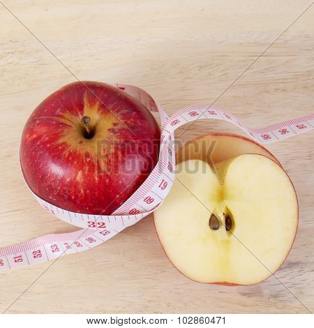 Red Apple With Centimeter On Wood Table For Diet Concept