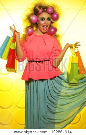 Girl with bright makeup and purchase in hands
