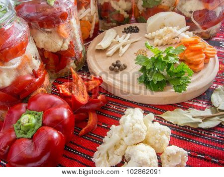 preparing picked bell peppers assorted with celery, carrots, pepper, parsley, horseradish, laurel