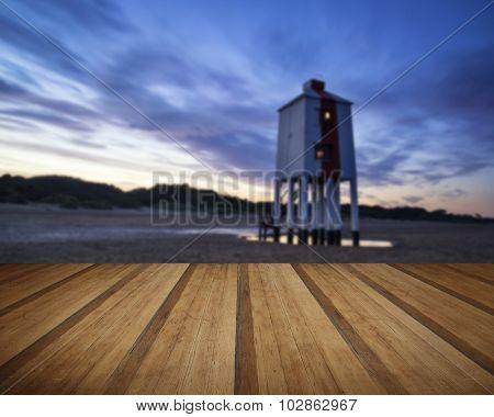 Beautiful Landscape Sunrise Stilt Lighthouse On Beach With Wooden Planks Floor