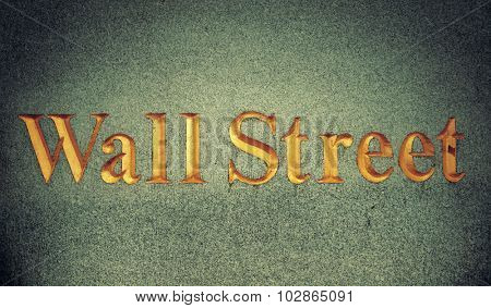Wall Street name on wall in Manhattan, New York City.