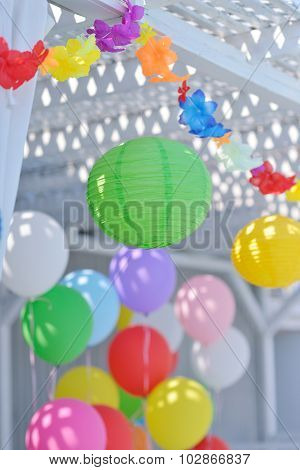 colored paper and balloons