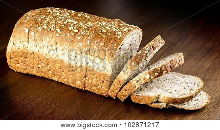 Fresh Whole Wheat Bread Against Wooden Background