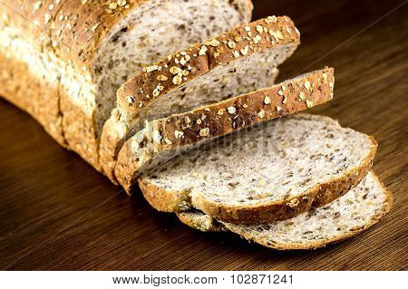 Macro Closeup Of Rustic Slices Whole Wheat Multi Grain Bread On Wooden Background