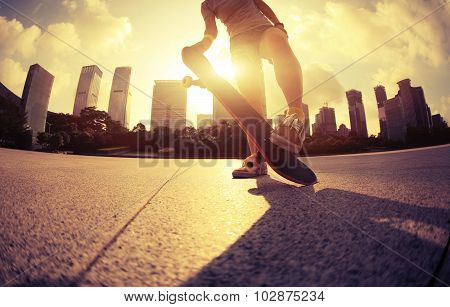 closeup of people skateboarding at sunrise city
