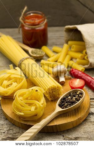 Ingredients For Cooking Pasta On Wooden Background. Chile Pepper, Cherry Tomatoes, Spices, Mushrooms