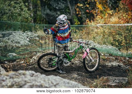 athlete mountainbiker stopped on the course