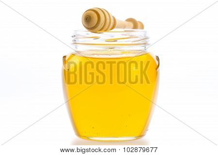 Glass Jar Of Fresh Honey With Drizzler Isolated On White Background