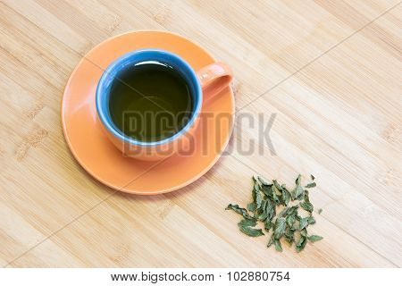 Cup Of Healthy Green Tea With Leaves