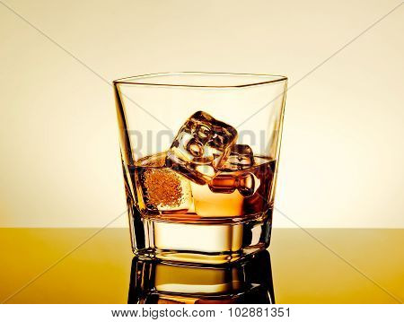 Whiskey In The Glass On Table With Reflection, Warm Tint Atmosphere