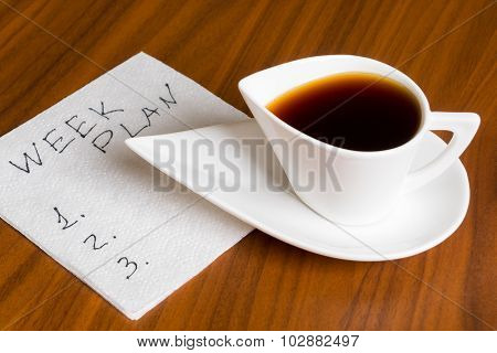 Coffee Cup With Handwriting Week Plan On Napkin