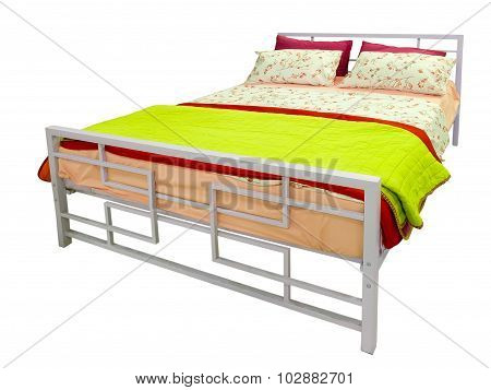 Bed With Colorful Blanket And Cushions