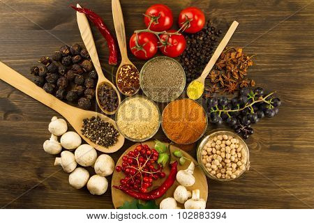 Wooden Table With Colorful Spices, Herbs And Vegetables.  Wooden Table With Colorful Spices. Asian C