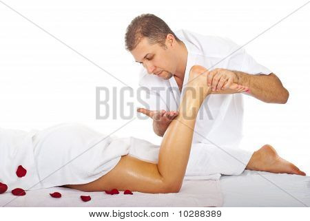 Therapist Man Massaging Woman's Leg