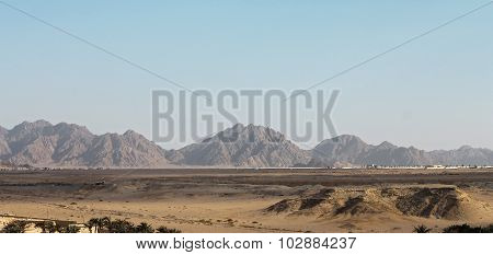 Egyptian Desert And Mysty Sky In The Daylight