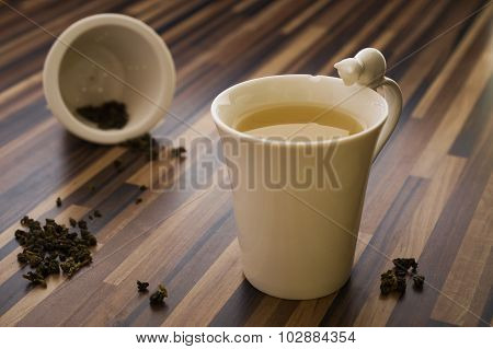 Green Tea In Decorated Tea Cup On Wood Table Clean
