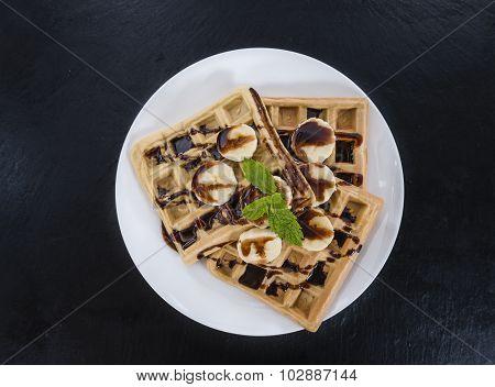 Waffles With Bananas And Chocolate Sauce