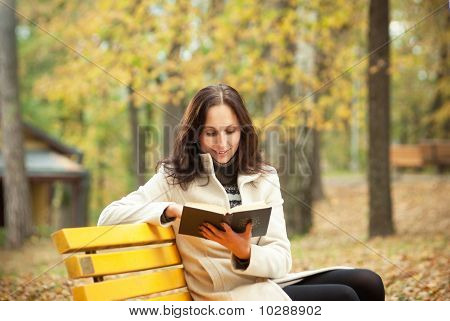 young student reading book