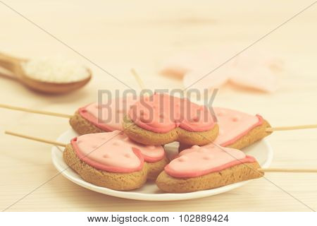 Delicious Fresh Cookies On A White Plate In The Form Of Heart On A Wooden Background.