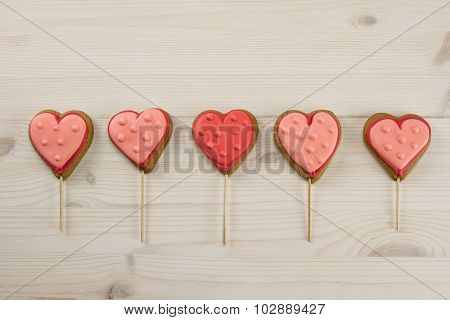 Delicious Fresh Cookies In The Shape Of A Heart On A Wooden Background.