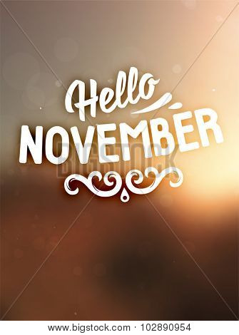 Autumn abstract vector banner. Typographic greeting card design. Blurred background. Hello November