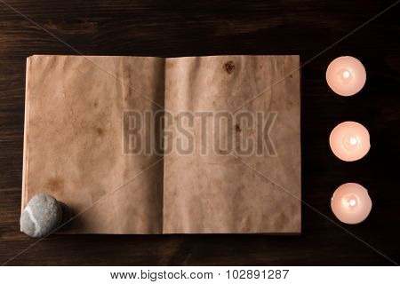 Beautiful Spa Composition With Aroma Candles And Empty Vintage Open Book On Wooden Background. Treat