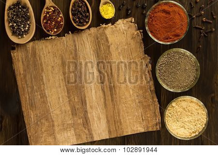 Sheet Old Vintage Paper With Spices On Wooden Background. Healthy Vegetarian Food. Recipe, Menu, Moc