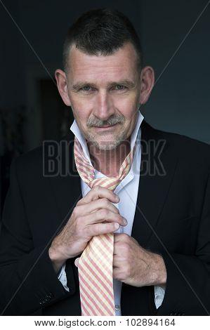 Handsome Man Tying His Tie