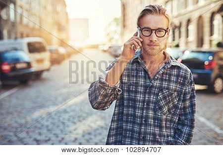 Closeup Portrait Of Young Man Talking On His Cellphone
