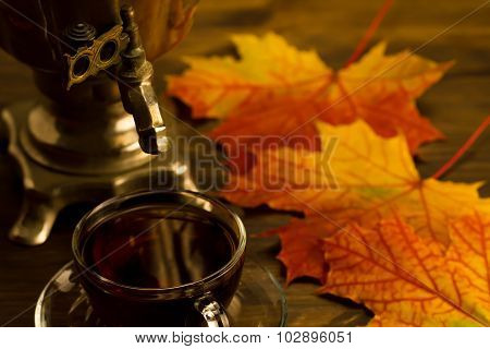 Tea Still Life With Samovar, Maple Leaves, On Wooden Background. Thanksgiving, Autumn, Russia