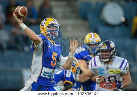 GRAZ, AUSTRIA - JUNE 27, 2014: QB Christoph Gubisch (#5 Giants) passes the ball during an Austrian football league game.