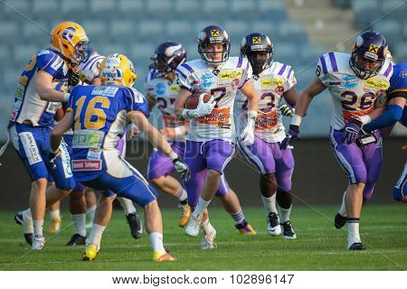 GRAZ, AUSTRIA - JUNE 27, 2014: WR Dominik Bubik (#7 Vikings) runs with the ball during an Austrian football league game.